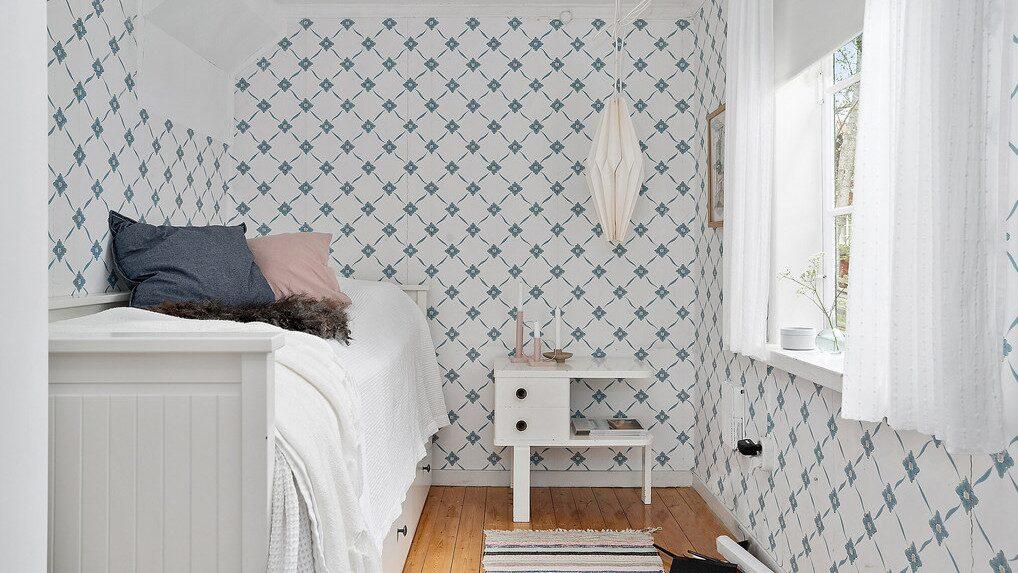 Ytterligare ett sovrum i lantlig stil.