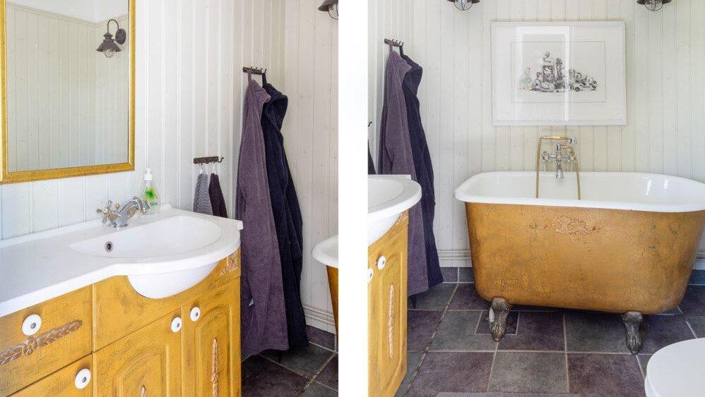 """Ett av flera badrum med """"gammeldags"""" badkar."""