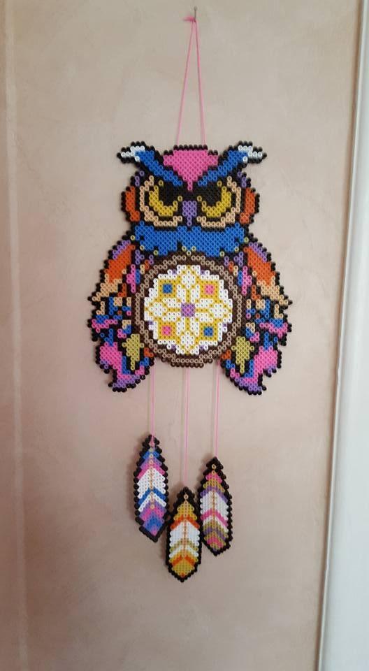 Här är det en vacker uggla med fjädrar som får pryda väggen.